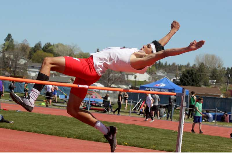STEELE HAUGEN - Nathan Rodriguez stretches for a leap of  5-02 at the Madras Invite May 2. The Buffalos travel to North Marion May 10-11, for the Tri-Valley League districts.