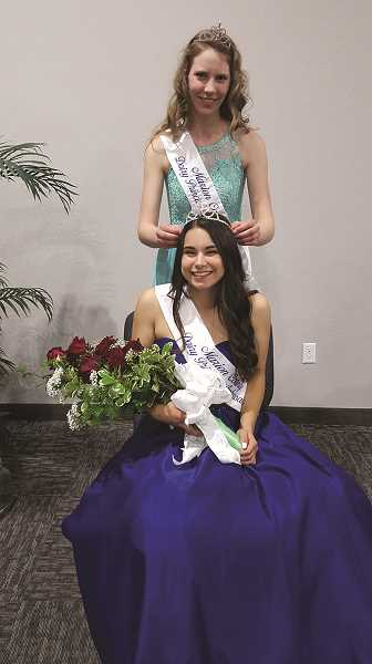 COURTESY PHOTO - St. Paul senior Taysha Veeman was crowned 2019 Marion County Dairy Princess, and was presented her tiara by Donata Doornenbal of Scio, the 2018 Princess.