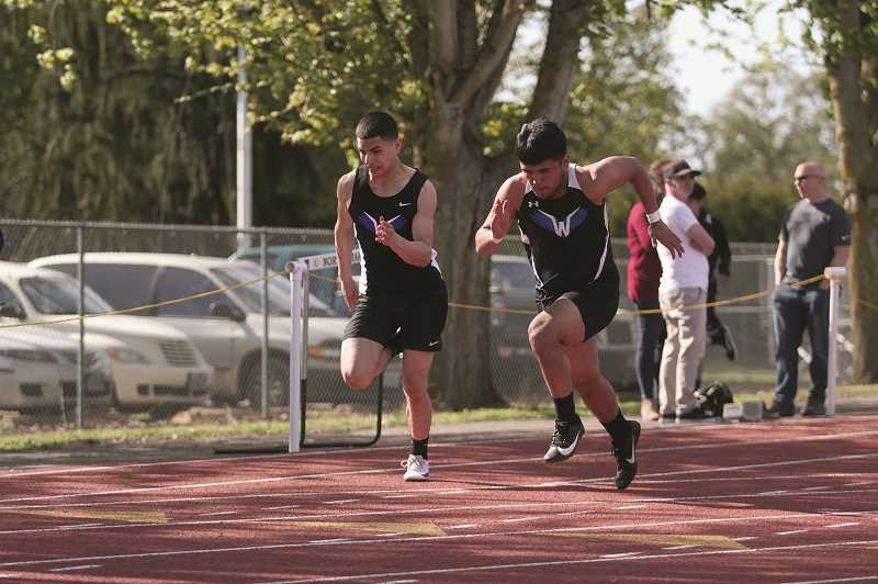 PMG PHOTO: PHIL HAWKINS - Woodburn senior Jesus Rodriguez-Fernandez (right) set a season-best time of 12.19 to finish fourth in the 100-meter dash at North Marion last week.