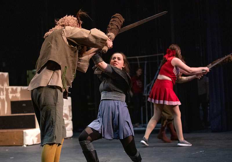 """PMG PHOTO: JONATHAN HOUSE - Samantha Katz, playing Tilly, fights off a Bugbear, played by Cormac Lister during rehearsal for """"She Kills Monsters."""""""