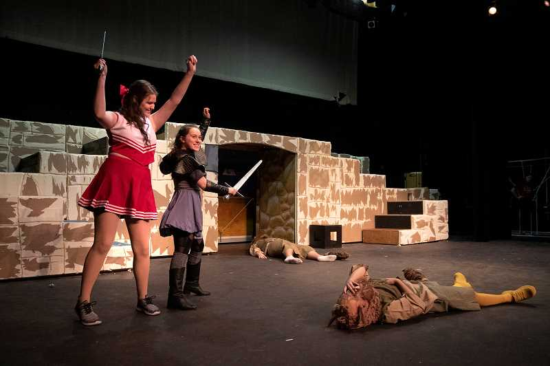 """PMG PHOTO: JONATHAN HOUSE - Abi Edwards, playing Agnes, and Samantha Katz, as Tilly, celebrate defeating the Bugbears during rehearsal for """"She Kills Monsters."""""""