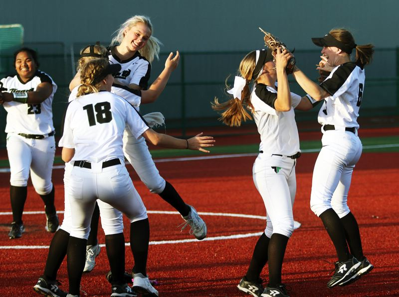 PMG PHOTO: DAN BROOD - Members of the Tigard High School softball team celebrate following the 5-4, 10-inning win at Tualatin on Monday.
