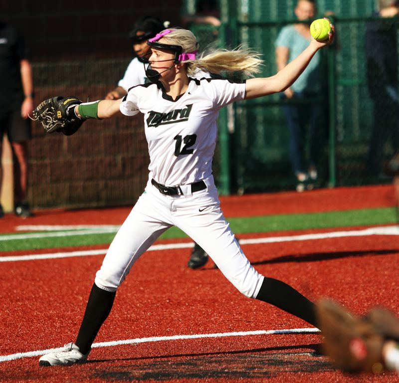 PMG PHOTO: DAN BROOD - Tigard freshman Makenna Reid gets ready to fire in a pitch for the Tigers in their 5-4 win at Tualatin on Monday.