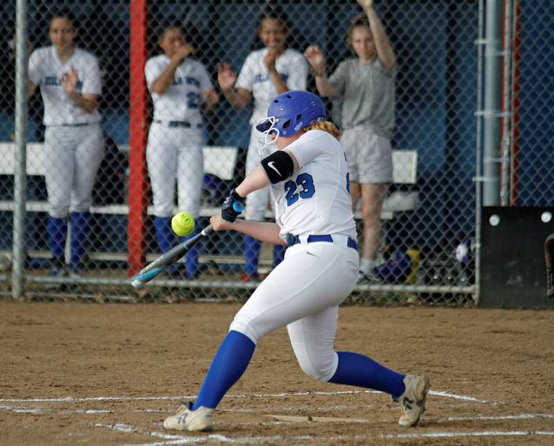 PMG PHOTO: WADE EVANSON - Hillsboro sophomore Natalee Dold takes a swing during the Spartans' game against La Salle earlier this season. The Sparts have won 11 games in a row.