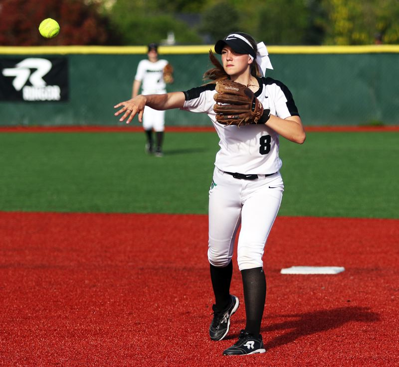 PMG PHOTO: DAN BROOD - Tigard senior second baseman Abby Soderquist makes a throw to first base during the Tigers' 10-inning win at Tualatin on Monday.