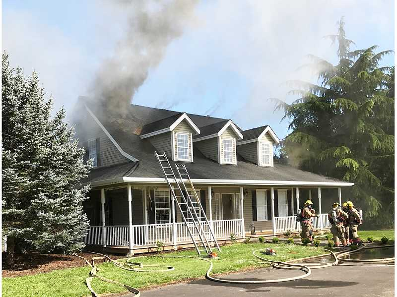 PHOTO COURTESY OF TVF&R - A Newberg home on Sunny Acres Road was severely damaged by fire Monday afternoon, rendering the building uninhabitable.
