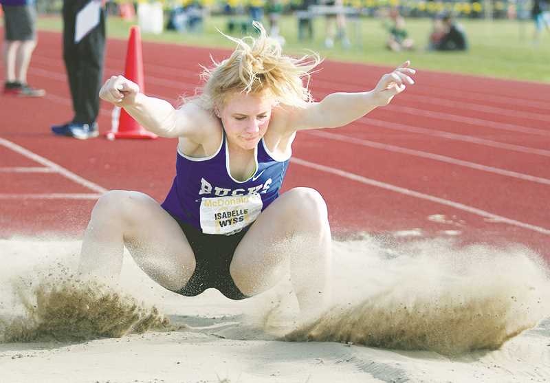 WOODBURN INDEPENDENT PHOTO: PHIL HAWKINS - St. Paul junior and defending 2A state triple jump champion Isabelle Wyss recorded her best mark of the season in the event, placing second at the Regis Twilight Meet with a distance of 34-00.