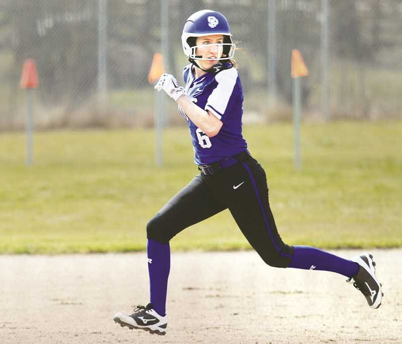 WOODBURN INDEPENDENT PHOTO: PHIL HAWKINS - St. Paul senior Sadie Smith set a program record with six RBIs in the Buckaroos' 15-4 win over Neah-Kah-Nie on April 30. Smith and teammate Rachel Vela combined to hit back-to-back inside the park home runs in the fourth inning.