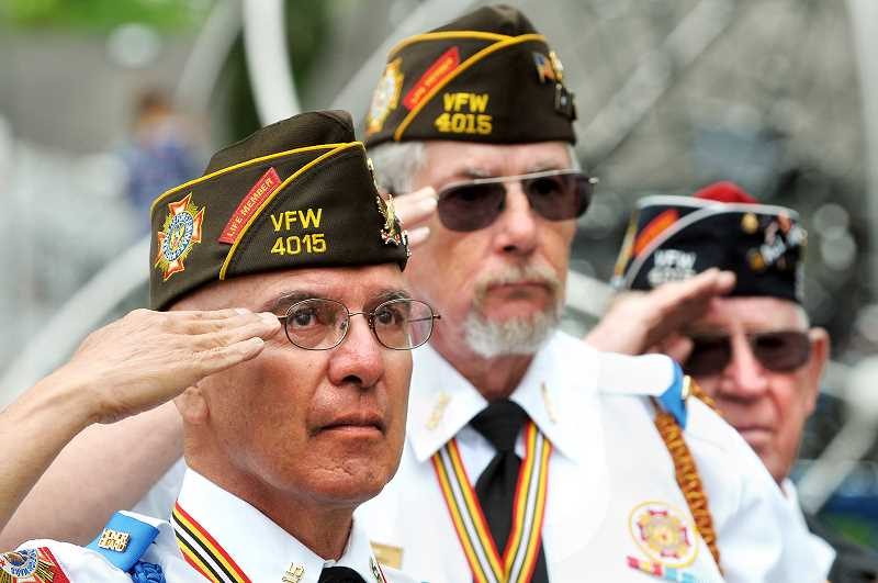 GRAPHIC FILE PHOTO - Members of the local VFW and American Legion posts traditionally attend the Memorial Day event in large numbers to honor the dead.