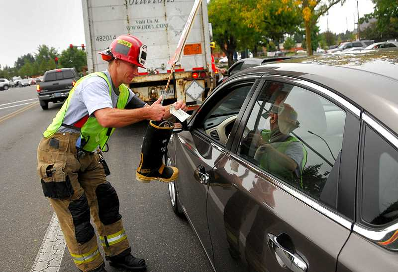 PMG FILE PHOTO  - All funds collected through Tualatin Valley Firefighters Union Local 1660's 2019 Fill the Boot events support MDA's life-enhancing programs.