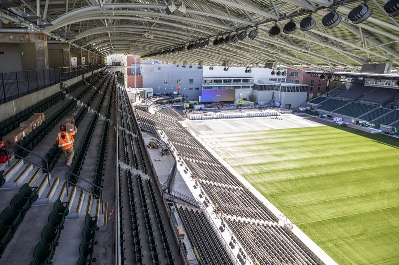 PMG PHOTO: JONATHAN HOUSE - A new roof stretching over the stadium's east-side seats features 923,748 tons of steel. The components were manufactured in California, shipped in pieces to Portland in 120 semi loads and then erected on site.