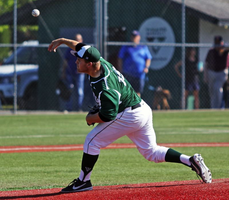 PMG PHOTO: DAN BROOD - Tigard High School senior C.J. Rivers fires in a pitch during the first inning of the Tigers' 5-3 league win over Tualatin on Tuesday.