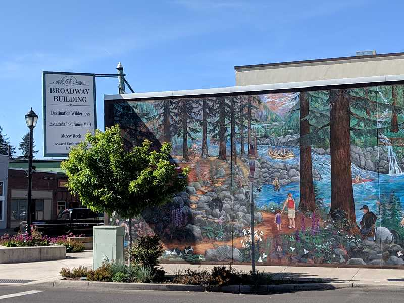 PMG PHOTO: EMILY LINDSTRAND - The Broadway Building is home to Mossy Rock, Award Embroidery, Estacada Insurance Mart, a three-bedroom apartment, and the Happy Trails mural,