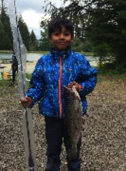 COURTESY PHOTO: MT. HOOD NATIONAL FOREST - A young angler shows of the fish he caught during the  2018 free fishing clinic at the Middle Fork Irrigation Pond.