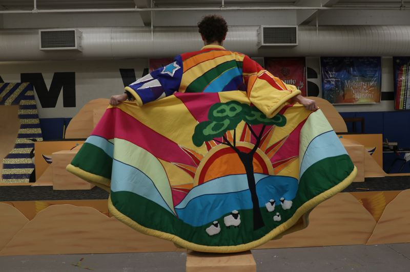 COURTESY PHOTO: SARA DEMPSEY/GRESHAM HIGH SCHOOL  - Troy Chittock as Joseph shows off the back of the amazing technicolor dreamcoat.