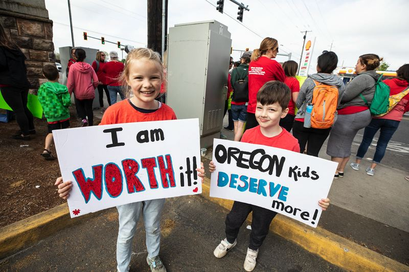 PMG PHOTO: JONATHAN HOUSE - Addison and Bennett Lee showed up to support their Cenntennial School District teachers for Oregon's Teacher Walkout Day.