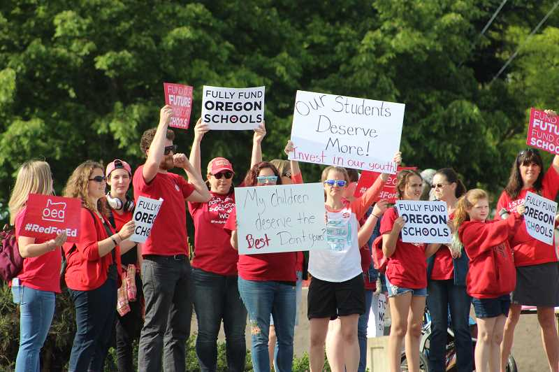 KRISTEN WOHLERS - Canby teachers and supporters rally on the side of Highway 99E on May 8.