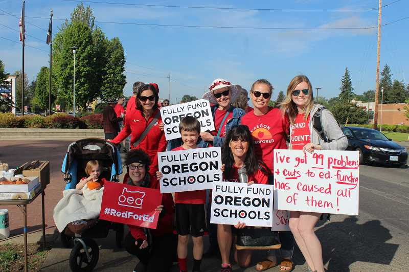 KRISTEN WOHLERS - A squad from Carus Elementary, including soon-to-be Canby Education Association President Stefanie Agar (front left), shows their support for better school funding.