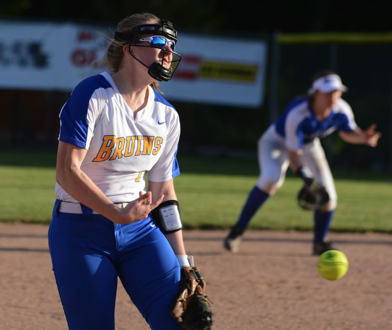 PMG PHOTO: DAVID BALL - Barlows Natalie Harrop lets loose with a pitch during the seventh inning of the Bruins 9-8 win over Clackamas on Monday.