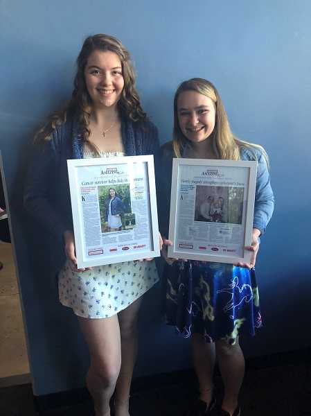 KRISTEN WOHLERS - Kaitlin Gartrell (left) and Mikaela Bjorn show off their Amazing Kids plaques at OMSI on Monday, April 29.