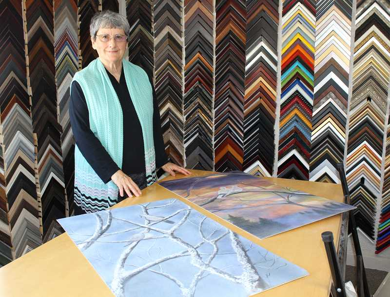 HOLLY M. GILL/MADRAS PIONEER - Carole Leone prepares her bird paintings for display at Art Adventure Gallery.