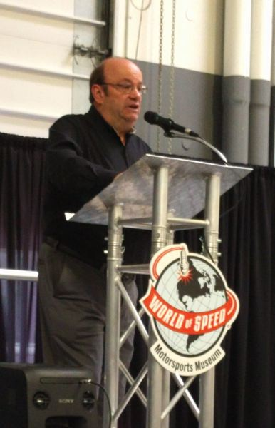 PMG PHOTO: JIM REDDEN - John Kraman, Mecum's director of consignments and TV commentator, speaking before the Northwest Automotive Trade Association at the World of Speed.