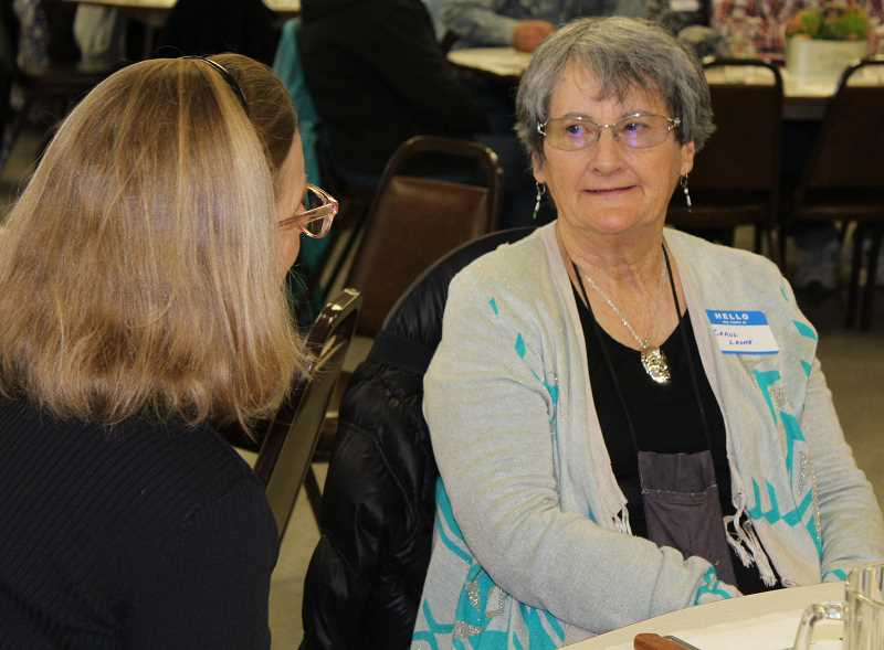 HOLLY M. GILL/MADRAS PIONEER - Carol Leone, the retired executive director of the Museum at Warm Springs, was the guest speaker at the annual meeting of the Jefferson County Historical Society. Leone visits with Karen McCarthy prior to her speech at the April event.