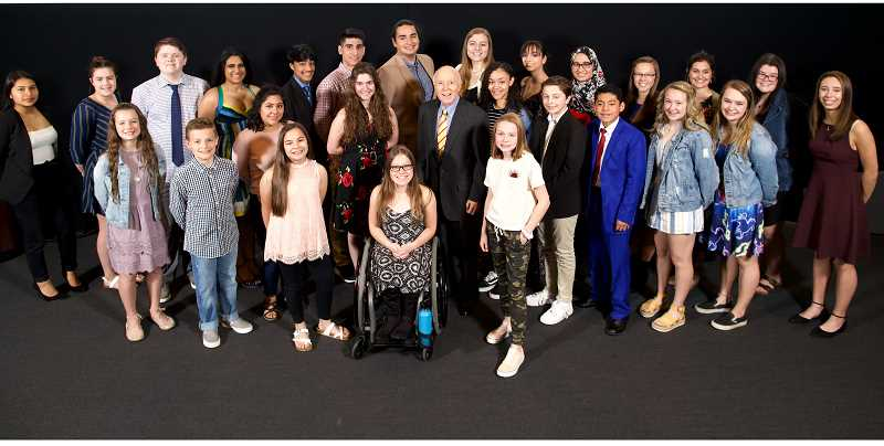 JAIME VALDEZ/PAMPLIN MEDIA - Dr. Robert Pamplin Jr., center, is surrounded by the young people honored as Amazing Kids, including Allison Turek, from the communities the company's newspapers serve.