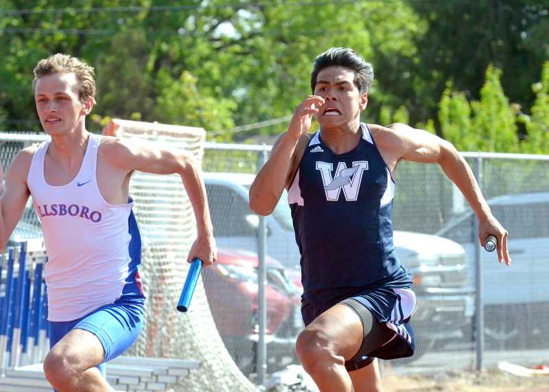 PMG PHOTO: TANNER RUSS - Henry Tellez anchors the 4x100-meter relay team that took first against Hillsboro.