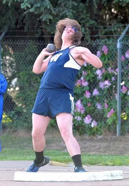 PMG PHOTO: TANNER RUSS - Senior Mike Church took first place in the shot put and javelin events against Hillsboro.
