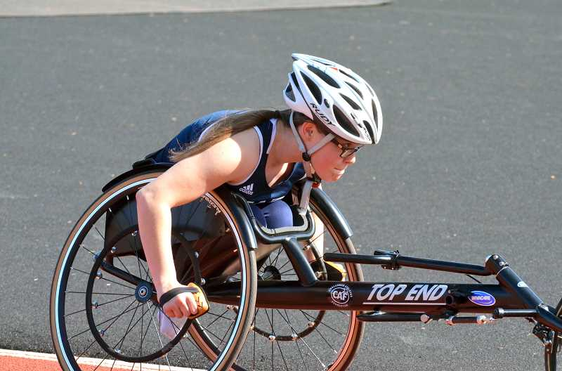 PMG PHOTO: TANNER RUSS - Senior para-athlete Kayla Bolnick competed in the 1,500 meters for the Wildcats.