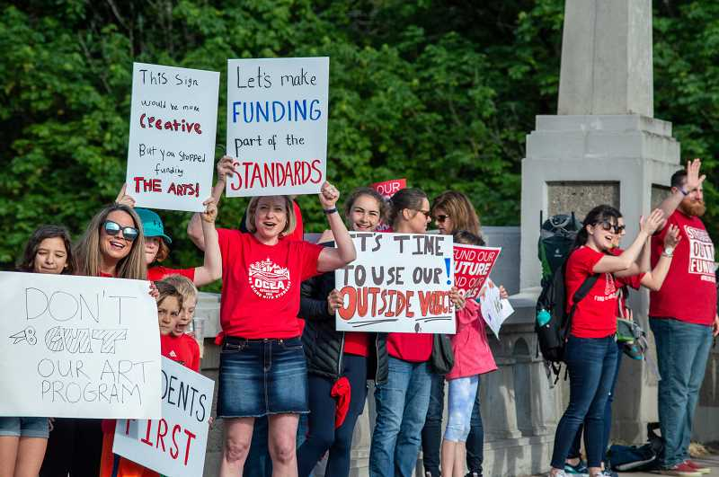 PMG PHOTO: CLARA HOWELL  - WL-WV educators and community members gathered May 8 at the West Linn-Oregon City Arch Bridge to advocate for fair funding in K-12 education.