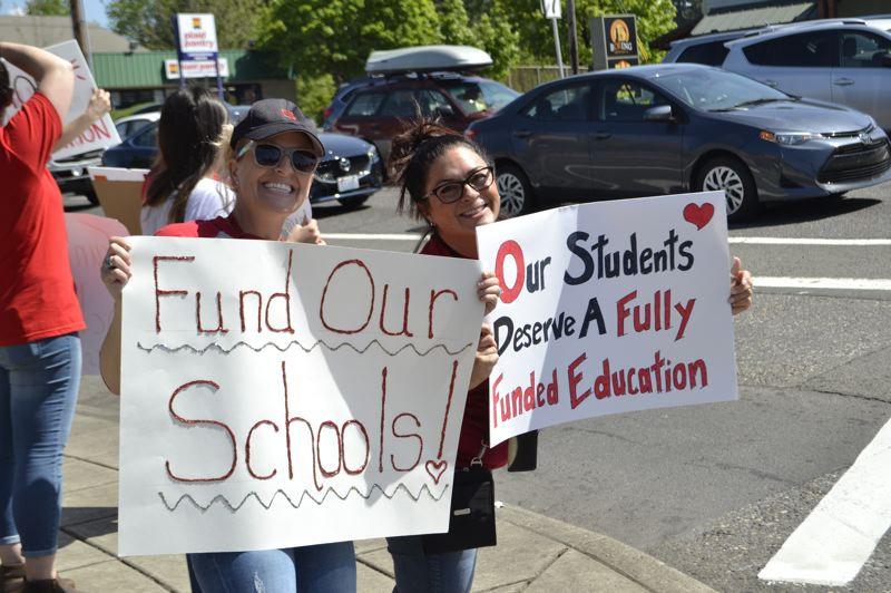 POST PHOTO: BRITTANY ALLEN - OTA teacher Nancy Blaesing and SHS teacher Sandi Carter were among dozens of Oregon Trail School District teachers who came out Wednesday, May 8, to protest for better funding for education.