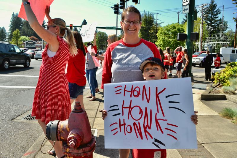POST PHOTO: BRITTANY ALLEN - Union president and OTA first-grade teacher Megan Smith was among the several teachers to demonstrate against a lack of funding for education on Wednesday.