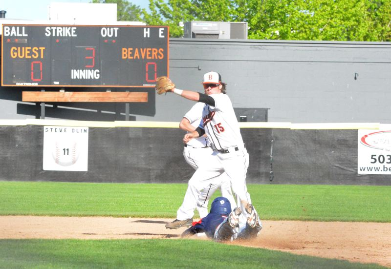 TIMES PHOTO: MATT SINGLEDECKER - Beaverton sophomore second baseman Connor Patrick tries to put down a tag against Westview.