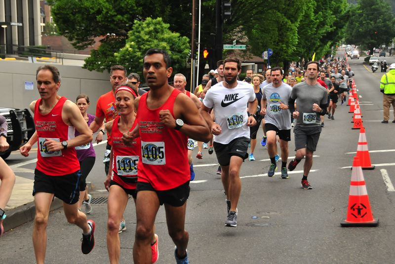 PMG FILE PHOTO - Runner zoom down State Street at the commencement of the 10k race at the 2018 Lake Run.