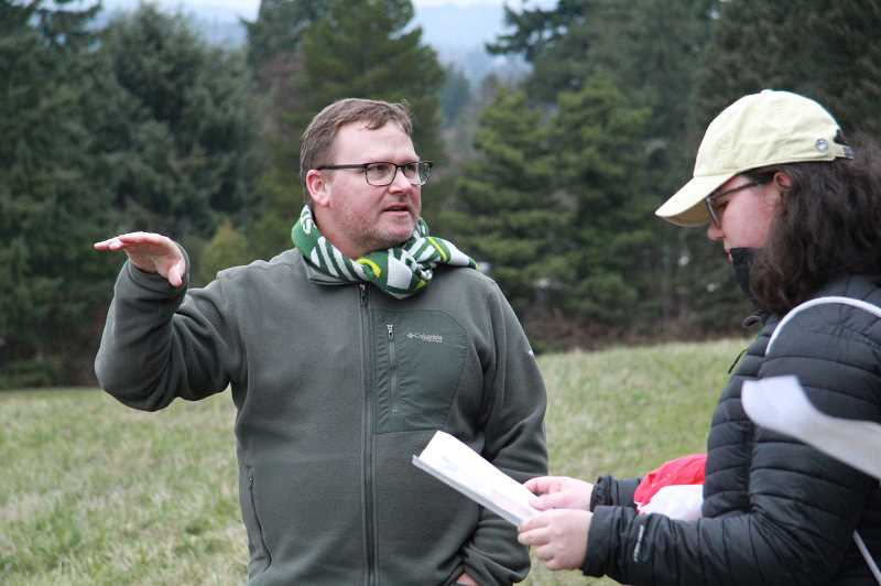 PMG PHOTO: SAM STITES - Lake Oswego Parks Director Ivan Anderholm leads the Parks and Natural Resources Advisory Board on a tour of Luscher Farm and the Farr Property where the proposed bike skills course could be built.