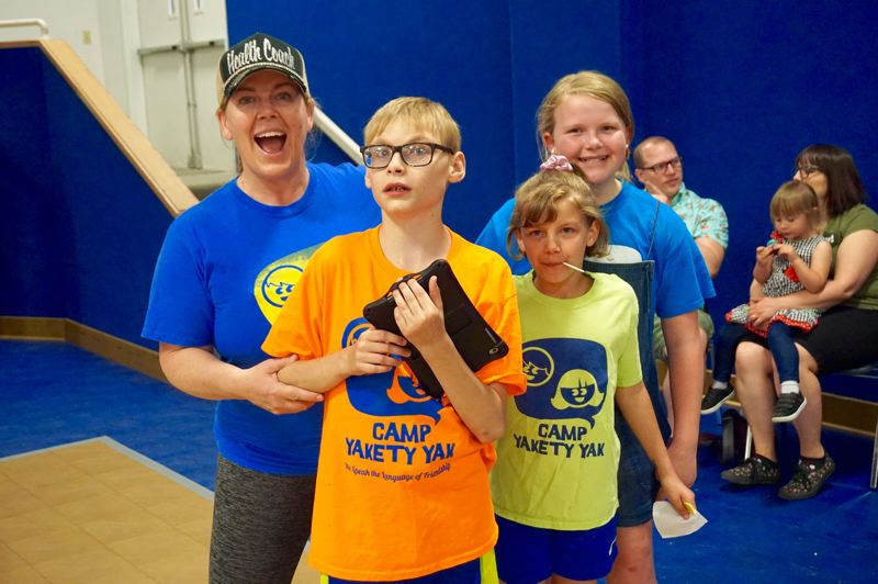 PMG PHOTO: CLAIRE HOLLEY - Mother Shannon Chollman with three of her four kids: Alex, Lucy and Mary (blue shirt).