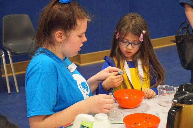 PMG PHOTO: CLAIRE HOLLEY - Silvia Soto (left) learns how to make slime with Yakety Yak counselor Norah Donaldson.
