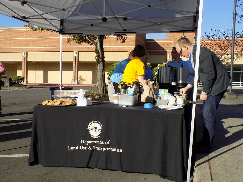 TIMES PHOTO: RAY PITZ - Free coffee and cookies were handed out to motorists at Peterkort Town Square Thursday to celebrate completion of the Sunset Highway off-ramp/Cedar Hills Boulevard intersection.