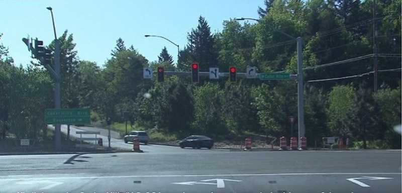 COURTESY OF KOIN 6 NEWS - A signalized intersection at the bottom of the eastbound Sunset Highway off-ramp at Cedar Hills Boulvard now offers motorists three directional choices, the most anticipated being the ability to turn left without fear of an acccident.