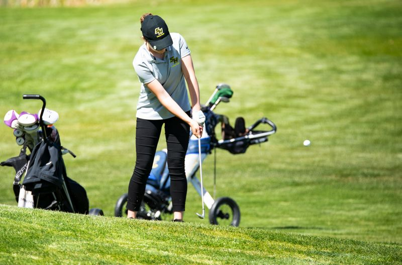 PMG PHOTO: LON AUSTIN - St. Helens High's Alexus Burgoyne hits a shot during a regional tournament this week in Prineville. She qualified for state.