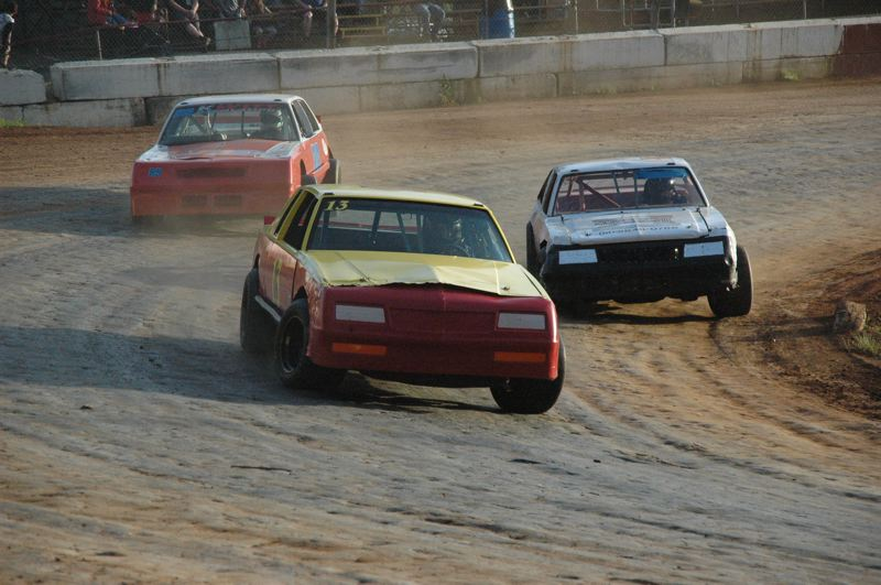COURTESY PHOTO: MIKE WEBER - Terry King (13) passes Portland's Tom Zywicki for the lead in the Street Stock main event during opening day at River City Speedway.