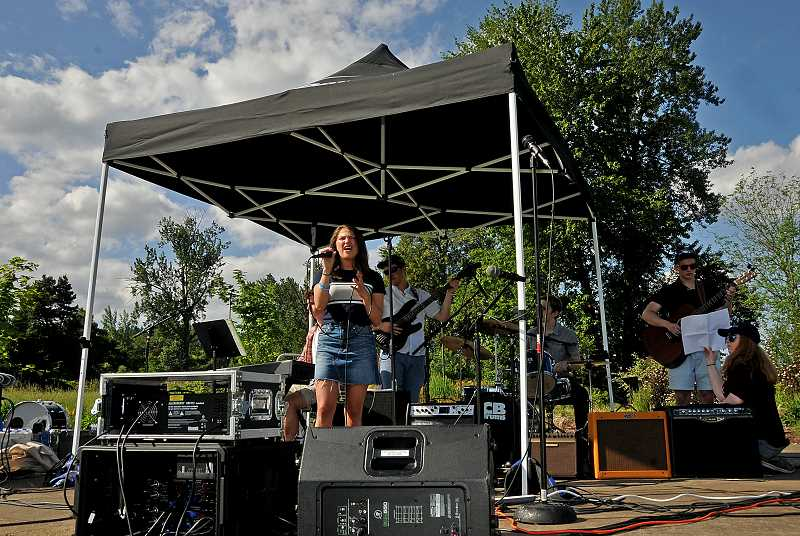 PMG PHOTO: VERN UYETAKE - Lakeridge class of 2018 grad Yelena Friedman and her bandmates perform at last years LOchella.