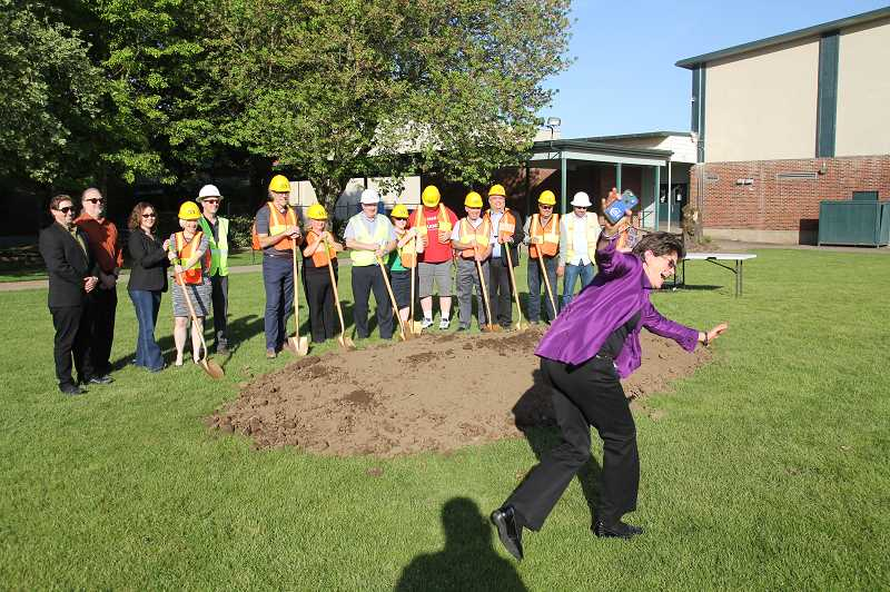 PMG PHOTO: JUSTIN MUCH - North Marion School District Superintendent Ginger Redlinger playfully photo bombs a groundbreaking photo op during a ceremony celebrating construction of a new 2-story high school wing.