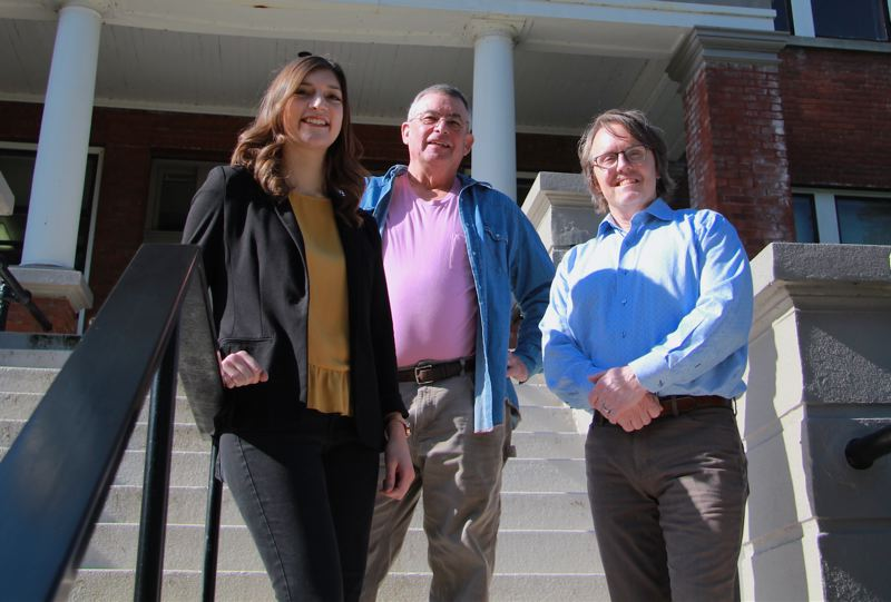 PMG FILE PHOTO - From left: Youth Villages Development Associate Sierra Parsons, Mark Browne and Youth Village Executive Director Andrew Grover pose on the steps of the former Christie School for Orphaned Girls on the Mary's Woods campus where Youth Villages now operates. Browne and Parsons recently unveiled their collaborative project 'Our Legacy, Our Future' which lines the halls of their facility.