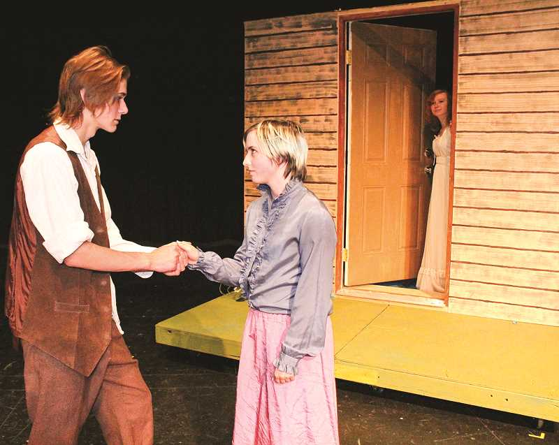 HOLLY SCHOLZ/CENTRAL OREGONIAN   - Jesse Tuck, played by CCHS junior Travis Bond, left, greets Winnie Foster, played by junior Zoe Poore, outside of her cottage as Grandma, played by sophomore Dakota Carpenter, looks on.