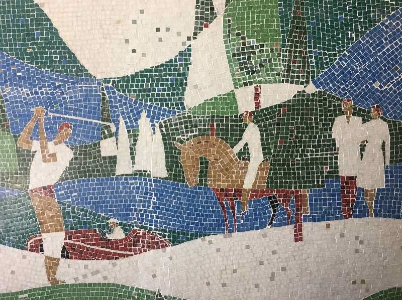 PMG FILE PHOTO - The Wizer mosaics fully restored now sit on the wall in their new home at The Windward near the entrance to the public parking garage.
