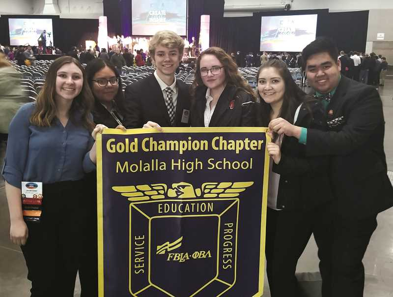COURTESY PHOTO: CORRI ELLIS - Molalla's officer team shows off the state gold champion chapter award.