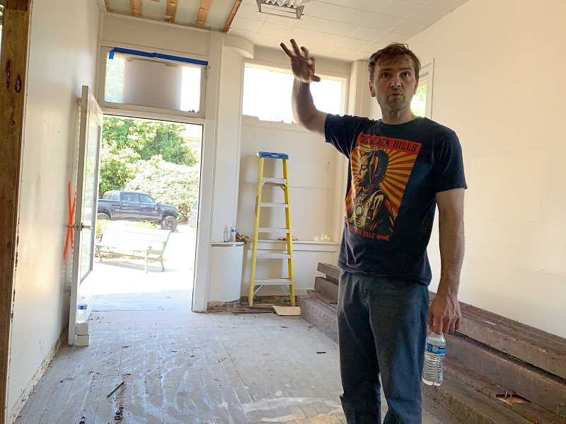 PMG PHOTO: GEOFF PURSINGER - Meridian co-owner Marc Ahrendt is working to renovate a historic building across from the Washington County courthouse. He and his wife, novelist Delilah Marvelle, hope to open the shop in 2020.